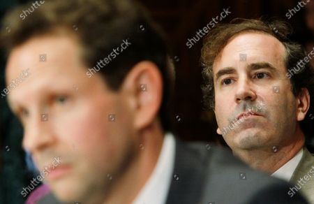 This photo from, shows Harry Markopolos, right, a fraud investigator, as he listens to Security Exchange Commission (SEC) testimony on Capitol Hill, during a Senate banking Committee hearing on Bernard Madoff. The SEC failed to heed credible warnings over 10 years about Madoff, before his Ponzi scheme came crashing down