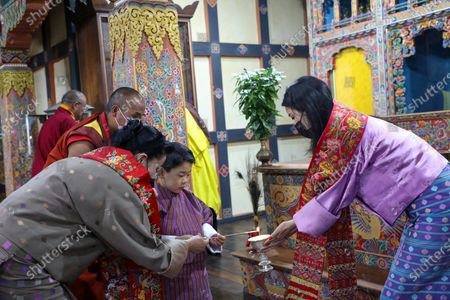 Her Majesty The Gyaltsuen and Her Majesty Gyalyum Tshering Yangdoen help Her Royal Highness light a butterlamp at the Dramitse Lhakhang. Founded in the 16th Century by Ani Choeten Zangmo, the granddaughter of Terton Pema Lingpa, is an important seat of the Peling Tradition in the east.