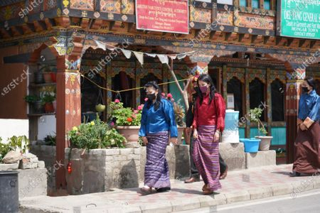 Her Majesty The Gyaltsuen, Her Majesty Gyalyum Tshering Yangdoen, and Ashi Yeatso Lhamo in Mongar during a visit to the tow