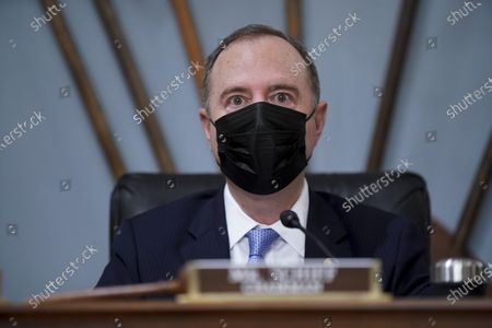 """United States Representative Adam Schiff (Democrat of California), Chairman, US House Permanent Select Committee on Intelligence, wears a protective mask while speaking during a hearing in Washington, D.C., U.S.,. The hearing follows the release of an unclassified report by the intelligence community detailing the U.S. and its allies will face """"a diverse array of threats"""" in the coming year, with aggression by Russia, China and Iran."""