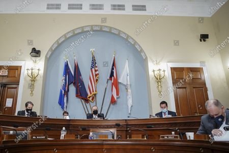 """United States Representative Adam Schiff (Democrat of California), Chairman, US House Permanent Select Committee on Intelligence, center left, wears a protective mask while speaking as US Representative Devin Nunes (Republican of California), Ranking Member, US House Permanent Select Committee on Intelligence, second right, and US Representative Jim Himes (Democrat of Connecticut), left, listen during a hearing in Washington, D.C., U.S.,. The hearing follows the release of an unclassified report by the intelligence community detailing the U.S. and its allies will face """"a diverse array of threats"""" in the coming year, with aggression by Russia, China and Iran."""