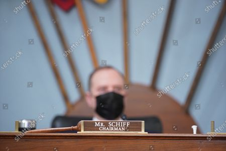 """A gavel next to the nameplate of United States Representative Adam Schiff (Democrat of California), Chairman, US House Permanent Select Committee on Intelligence, during a hearing in Washington, D.C., U.S.,. The hearing follows the release of an unclassified report by the intelligence community detailing the U.S. and its allies will face """"a diverse array of threats"""" in the coming year, with aggression by Russia, China and Iran."""