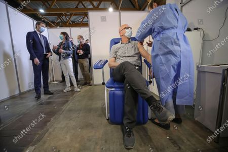 Belgium's Prime Minister Alexander De Croo (L) visits at the Covid-19 vaccination village set up in the Heysel site of the Brussels Expo exhibition halls, in Brussels, Belgium, 15 April 2021.