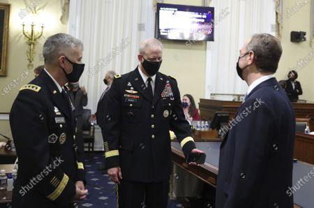Stock Picture of Director Lt. General Scott Berrier, center, National Security Agency (NSA) Director Gen. Paul Nakasone and Rep. Adam Schiff, D-Calif., right, talk before a House Intelligence Committee hearing on Capitol Hill in Washington