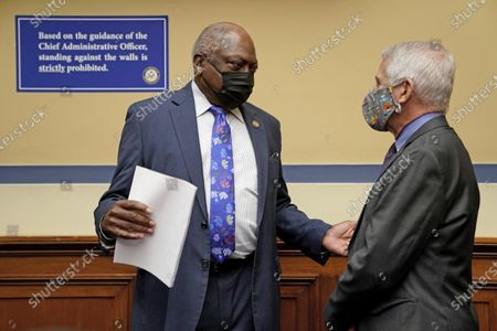 Dr. Anthony Fauci, director of the National Institute of Allergy and Infectious Diseases, speaks with Rep. Jim Clyburn, D-S.C., before a House Select Subcommittee on the Coronavirus Crisis on the Capitol Hill in Washington