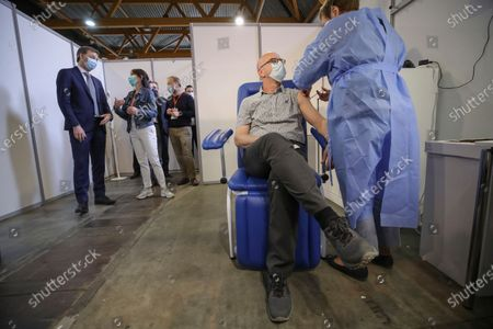 Belgium's Prime Minister Alexander De Croo during a visit to the Covid-19 vaccination village setup in the Heysel site of the Brussels Expo exhibition halls in Brussels.