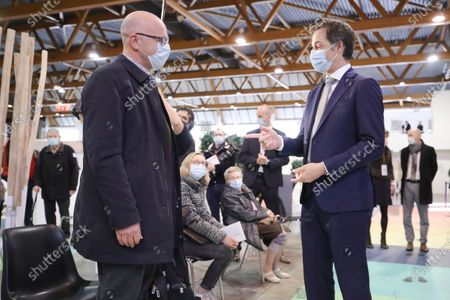 Stock Image of Belgium's Prime Minister Alexander De Croo during a visit to the Covid-19 vaccination village setup in the Heysel site of the Brussels Expo exhibition halls in Brussels.