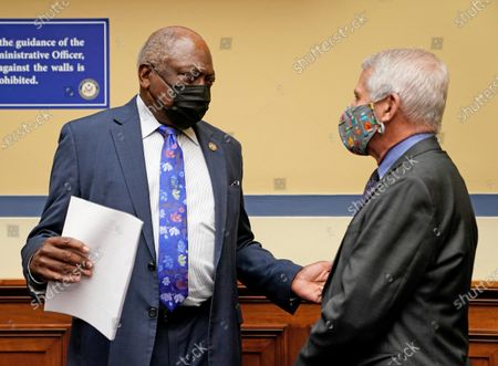Dr. Anthony Fauci (R) greets Rep. Jim Clyburn (L), Democrat of South Carolina, before the start of the House Select Subcommittee on the Coronavirus Crisis hearing on the Capitol Hill in Washington, DC, USA, 15 April 2021.