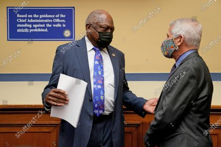 Infectious Diseases Director Dr. Anthony Fauci (R) talks to Rep. Jim Clyburn, D-SC, before testifying before the House Select Subcommittee on the Coronavirus Crisis at the U.S. Capitol in Washington DC, on Thursday, April 15, 2021.
