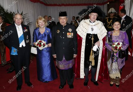 Britain's Prince Richard, the Duke of Gloucester, left, poses with Susilo Bambang Yudhoyono, center, the President of the Republic of Indonesia, accompanied by his wife Ani Bambang Yudhoyono, in central London. Buckingham Palace on Thursday, April 15, 2021 released the broad outlines of the program for Prince Philip's funeral, revealing that William and Harry's cousin Peter Phillips would walk between the princes as they escort the coffin to St. George's Chapel at Windsor Palace. The Duke of Gloucester is one of the invited guests