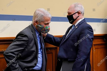 Dr. Anthony Fauci, the nation's top infectious disease expert, left, talks with House Minority Whip Steve Scalise, R-La., following a House Select Subcommittee on the Coronavirus Crisis hearing on Capitol Hill in Washington