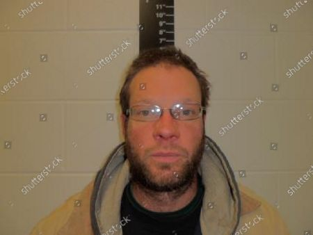 This December 2015 photo provided by the Iowa Department of Corrections, shows Michael Lang, of Grundy Center, Iowa. Lang, 41, is charged with murder in the, shooting of Iowa State Patrol Sgt. Jim Smith during a violent standoff at his home. An investigator says he was stunned to learn that Lang was a candidate for county sheriff in the November 2020 election
