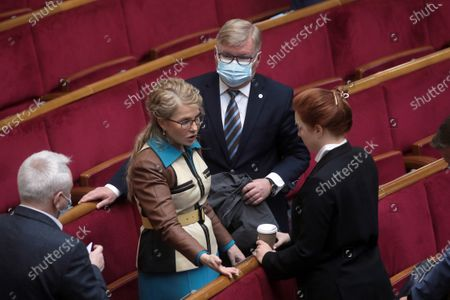 Batkivshchyna faction leader, MP Yulia Tymoshenko (C) talks to her colleagues during the regular sitting of the Ukrainian parliament, Kyiv, capital of Ukraine.