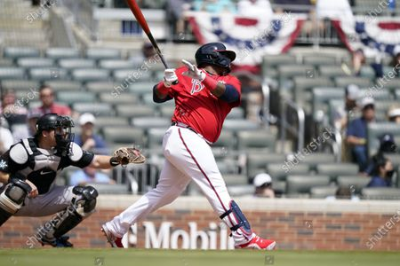 Stock Picture of Atlanta Braves' Pablo Sandoval (48) hits a home run in the sixth inning of a baseball game against the Miami Marlins, in Atlanta