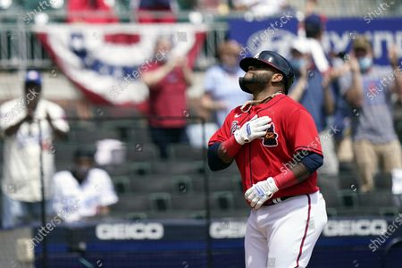 Stock Photo of Atlanta Braves' Pablo Sandoval (48) reacts after hitting home run in the sixth inning of a baseball game against the Miami Marlins, in Atlanta