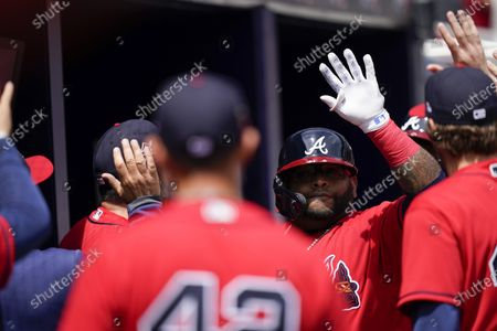 Atlanta Braves' Pablo Sandoval, center right, celebrates after scoring a home run in the sixth inning of a baseball game against the Miami Marlins, in Atlanta