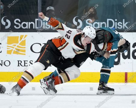 Stock Image of Anaheim Ducks defenseman Josh Manson (42) fights with San Jose Sharks center Dylan Gambrell (7) during the third period of an NHL hockey game, in San Jose, Calif