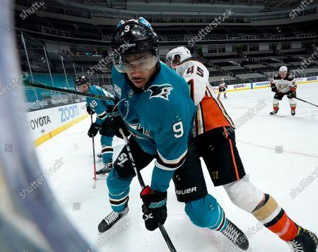 San Jose Sharks left wing Evander Kane (9) in action against Anaheim Ducks defenseman Andy Welinski (45) during the third period of an NHL hockey game, in San Jose, Calif