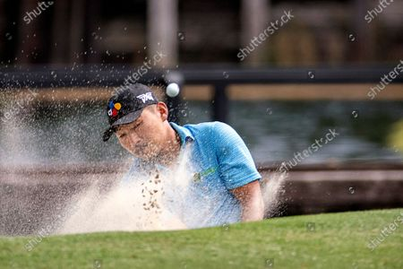 Sung Kang, of South Korea, hits out of a bunker on the seventh hole during the first round of the RBC Heritage golf tournament in Hilton Head Island, S.C