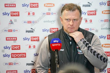 Mark Robins of Coventry City (Manager) gestures and reacts whilst being interviewed after the match during the EFL Sky Bet Championship match between Rotherham United and Coventry City at the AESSEAL New York Stadium, Rotherham