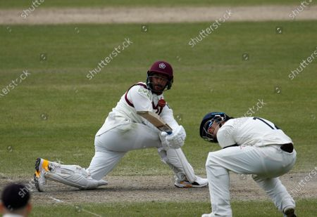 Saif Zaib of Northamptonshire sweeps as Rob Jones of Lancashire takes evasive action; Emirates Old Trafford, Manchester, Lancashire, England; English County Cricket, Lancashire versus Northants.