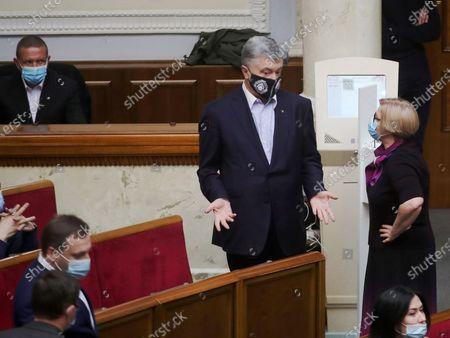 European Solidarity MPs Petro  Poroshenko and Iryna Herashchenko (L to R) attend an extraordinary sitting of the Verkhovna Rada, Kyiv, capital of Ukraine.