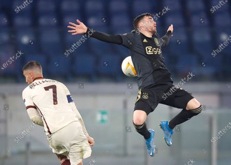 Roma's Lorenzo Pellegrini, left, and Ajax's Nicolas Tagliafico challenge for the ball during the Europa League second leg quarterfinal soccer match between Roma and Ajax at Rome's Olympic stadium, Italy