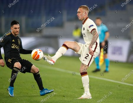 Roma's Rick Karsdorp, right, controls the ball ahead of Ajax's Nicolas Tagliafico during the Europa League second leg quarterfinal soccer match between Roma and Ajax at Rome's Olympic stadium, Italy