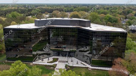 """This image taken with a drone shows exterior of the headquarters of the Virginia Employment Commission in Richmond, Va., . Five women are suing the leader of the Virginia agency that handles unemployment benefits, alleging """"gross failures"""" to provide needed help as required by law amid the coronavirus pandemic. The class-action lawsuit was filed Thursday morning, April 15, 2021, in federal court in Richmond on behalf of the plaintiffs by several legal aid groups and their pro bono partners. Named as the defendant is Ellen Marie Hess, head of the Virginia Employment Commission"""
