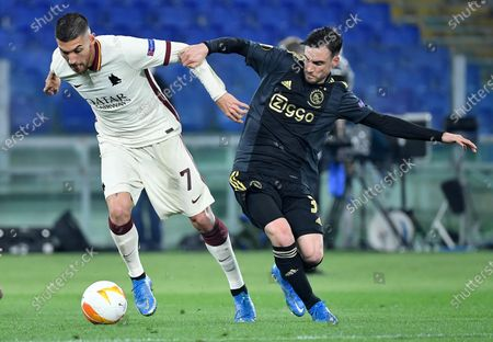 AS Roma's Lorenzo Pellegrini (L) vies for the ball with Ajax Amsterdam's Nicolas Tagliafico during the UEFA Europa League quarterfinal, second leg soccer match between AS Roma and Ajax Amsterdam in Rome, Italy, 15 April 2021.