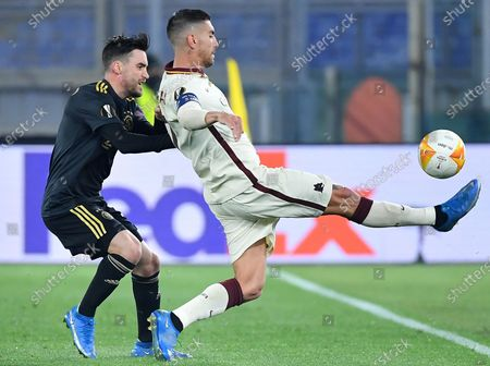 AS Roma's Lorenzo Pellegrini (R) vies for the ball with Ajax Amsterdam's Nicolas Tagliafico during the UEFA Europa League quarterfinal, second leg soccer match between AS Roma and Ajax Amsterdam in Rome, Italy, 15 April 2021.