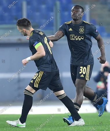 Ajax Amsterdam's Brian Brobbey (R) celebrates with his teammate Dusan Tadic after scoring the 0-1 goal during the UEFA Europa League quarterfinal, second leg soccer match between AS Roma and Ajax Amsterdam in Rome, Italy, 15 April 2021.