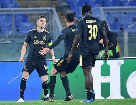 Ajax Amsterdam's Dusan Tadic (L) celebrates with his teammates after scoring a goal that was later disallowed during the UEFA Europa League quarterfinal, second leg soccer match between AS Roma and Ajax Amsterdam in Rome, Italy, 15 April 2021.