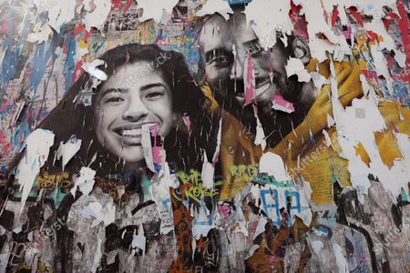 LOS ANGELES, CA - MARCH 13, 2021- A memorial mural of Kobe and Gigi Bryant by Mr. Brainwash is in tatters a year after it was created on La Brea Avenue in Los Angeles on March 13, 2021. (Genaro Molina / Los Angeles Times)