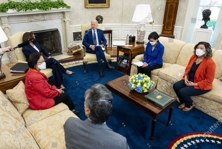 US President Joe Biden, center, speaks as US Vice President Kamala Harris, left, listens during a meeting with the Congressional Asian Pacific American Caucus Executive Committee including Representative Mark Takano, a Democrat from California, from bottom left, Senator Mazie Hirono, a Democrat from Hawaii, Representative Judy Chu, a Democrat from California, and Representative Grace Meng, a Democrat from New York, in the Oval Office of the White House in Washington, DC, USA, on 15 April 2021.