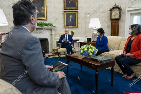 US President Joe Biden, center, speaks during a meeting with the Congressional Asian Pacific American Caucus Executive Committee including Representative Mark Takano, a Democrat from California, from left, Representative Judy Chu, a Democrat from California, and Representative Grace Meng, a Democrat from New York, in the Oval Office of the White House in Washington, DC, USA, on 15 April 2021.