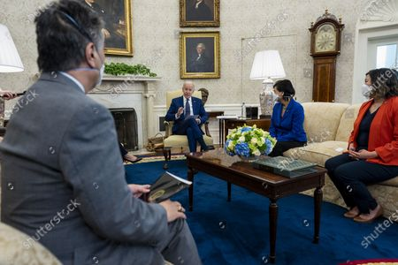 U.S. President Joe Biden, center, speaks during a meeting with the Congressional Asian Pacific American Caucus Executive Committee including Representative Mark Takano, a Democrat from California, from left, Representative Judy Chu, a Democrat from California, and Representative Grace Meng, a Democrat from New York, in the Oval Office of the White House in Washington, D.C., U.S.,. The Biden administration imposed a raft of new sanctions on Russia, including long-feared restrictions on buying new sovereign debt, in retaliation for alleged misconduct including the SolarWinds hack and efforts to disrupt the U.S. election.