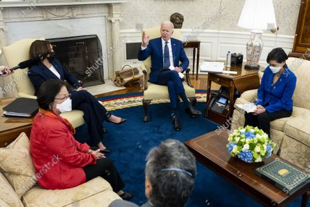 President Joe Biden (C) speaks as Vice President Kamala Harris (L) listens during a meeting with the Congressional Asian Pacific American Caucus Executive Committee including Rep. Mark Takano, D-CA., from bottom left, Sen. Mazie Hirono, D-HI. and Rep. Grace Meng, D-NY., in the Oval Office of the White House in Washington, DC, on Thursday, April 15, 2021.