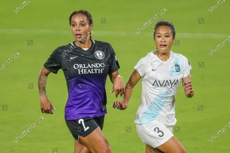 Orlando Pride forward Sydney Leroux (2) and Gotham defender Caprice Dydasco (3) during an NWSL Challenge Cup soccer match, in Orlando, Fla