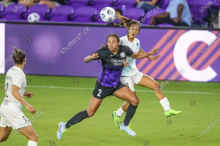 Orlando Pride forward Sydney Leroux (2) and Gotham defender Caprice Dydasco (3), right, vie for a header during an NWSL Challenge Cup soccer match, in Orlando, Fla