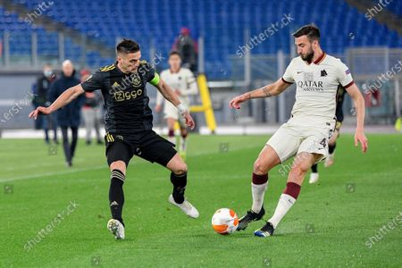 Dusan Tadic of AFC Ajax and Bryan Cristante of AS Roma seen in action