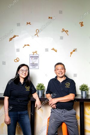 Stock Image of Portrait of chef and Owner of Cluck2Go, Qi Yang along with his daughter Jenny Yang at Cluck2Go on Monday, Oct. 19, 2020 in Pasadena, CA. (Mariah Tauger / Los Angeles Times)