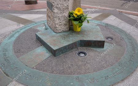A pot of yellow daisies is seen on the Boston Marathon Bombing Memorial in Boston, Massachusetts, USA, on 'One Boston Day,' and the 8th anniversary of the bombing, 15 April 2021. On 15 April 2013, two pressure cooker bombs were detonated by the Tsarnaev brothers, Tamerlan and Dzhokhar, near the finish line, killing three spectators and injuring over 250 others. Tamerlan was later killed in a shoot out with police and Dzhokar captured and later sentenced to death following a trial, that was since vacated in July 2020 and is now awaiting a new trial. The Boston Marathon 124th running was cancelled in 2020 due to the coronavirus pandemic and the 125th is now scheduled to be held on 11 October 2021.
