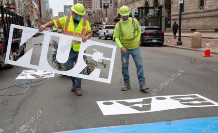 Jeff Schatz (L) and Will Belezos (R) of RoadSafe Traffic Systems, prepare to paint the Boston Marathon Finish Line on Boylston Street in Boston, Massachusetts, USA, on 'One Boston Day,' 15 April 2021. On 15 April 2013, two pressure cooker bombs were detonated by the Tsarnaev brothers, Tamerlan and Dzhokhar, near the finish line, killing three spectators and injuring over 250 others. Tamerlan was later killed in a shoot out with police and Dzhokar captured and later sentenced to death following a trial, that was since vacated in July 2020 and is now awaiting a new trial. The Boston Marathon 124th running was cancelled in 2020 due to the coronavirus pandemic and the 125th is now scheduled to be held on 11 October 2021.