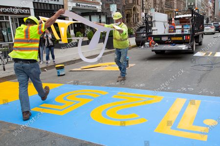 Jeff Schatz (L) and Will Belezos (R) of RoadSafe Traffic Systems, remove a stencil as they paint the Boston Marathon Finish Line on Boylston Street in Boston, Massachusetts, USA, on 'One Boston Day', and the eighth anniversary of the bombing, 15 April 2021. Myers ran the route of the marathon in about five hours. On 15 April 2013, two pressure cooker bombs were detonated by the Tsarnaev brothers, Tamerlan and Dzhokhar, near the finish line, killing three spectators and injuring over 250 others. Tamerlan was later killed in a shoot out with police and Dzhokar captured and later sentenced to death following a trial, that was since vacated in July 2020 and is now awaiting a new trial. The Boston Marathon 124th running was cancelled in 2020 due to the coronavirus pandemic and the 125th is now scheduled to be held on 11 October 2021.