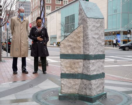 Boston Athletic Association Chief Executive Officer Tom Girlk (L) pauses with acting Boston Mayor Kim Janey (R) at one of the two Boston Marathon Bombing Memorials, on Boylston Street in Boston, Massachusetts, USA, on 'One Boston Day', and the eighth anniversary of the bombing, 15 April 2021. On 15 April 2013, two pressure cooker bombs were detonated by the Tsarnaev brothers, Tamerlan and Dzhokhar, near the finish line, killing three spectators and injuring over 250 others. Tamerlan was later killed in a shoot out with police and Dzhokar captured and later sentenced to death following a trial, that was since vacated in July 2020 and is now awaiting a new trial. The Boston Marathon 124th running was cancelled in 2020 due to the coronavirus pandemic and the 125th is now scheduled to be held on 11 October 2021.