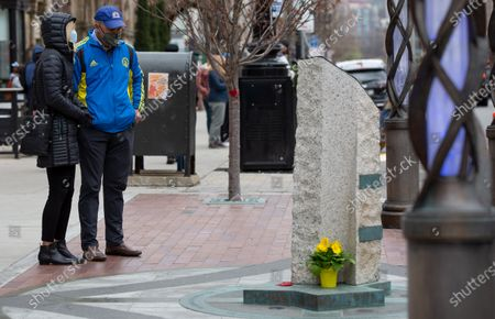 Stock Image of Joe (R) and Nancy Craven (R) pause while standing near the spot where their son was injured and a memorial now is located, near the Boston Marathon finish line on Boylston Street in Boston, Massachusetts, USA, on 'One Boston Day', and the eighth anniversary of the bombing, 15 April 2021. On 15 April 2013, two pressure cooker bombs were detonated by the Tsarnaev brothers, Tamerlan and Dzhokhar, near the finish line, killing three spectators and injuring over 250 others. Tamerlan was later killed in a shoot out with police and Dzhokar captured and later sentenced to death following a trial, that was since vacated in July 2020 and is now awaiting a new trial. The Boston Marathon 124th running was cancelled in 2020 due to the coronavirus pandemic and the 125th is now scheduled to be held on 11 October 2021.