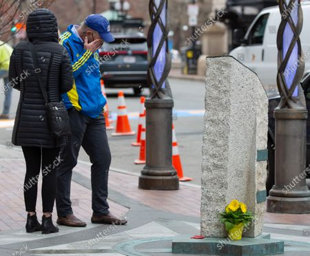 Stock Picture of Joe (R) and Nancy Craven (R) pause as Joe wipes tears away while standing near the spot where their son was injured and a memorial now is located, near the Boston Marathon finish line on Boylston Street in Boston, Massachusetts, USA, on 'One Boston Day', and the eighth anniversary of the bombing, 15 April 2021. On 15 April 2013, two pressure cooker bombs were detonated by the Tsarnaev brothers, Tamerlan and Dzhokhar, near the finish line, killing three spectators and injuring over 250 others. Tamerlan was later killed in a shoot out with police and Dzhokar captured and later sentenced to death following a trial, that was since vacated in July 2020 and is now awaiting a new trial. The Boston Marathon 124th running was cancelled in 2020 due to the coronavirus pandemic and the 125th is now scheduled to be held on 11 October 2021.