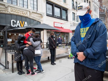 During a moment of silence on the eighth anniversary of the Boston Marathon Bombing, a man (R) bows his head while wearing a 'MR8' hat that commemorates Boston Marathon Bombing victim, eight-year-old Martin Richards, while friends and members of the Perez family (L) embrace at the spot where they survived the bombing, in Boston, Massachusetts, USA, on 'One Boston Day', and the eighth anniversary of the bombing, 15 April 2021. On 15 April 2013, two pressure cooker bombs were detonated by the Tsarnaev brothers, Tamerlan and Dzhokhar, near the finish line, killing three spectators and injuring over 250 others. Tamerlan was later killed in a shoot out with police and Dzhokar captured and later sentenced to death following a trial, that was since vacated in July 2020 and is now awaiting a new trial. The Boston Marathon 124th running was cancelled in 2020 due to the coronavirus pandemic and the 125th is now scheduled to be held on 11 October 2021.