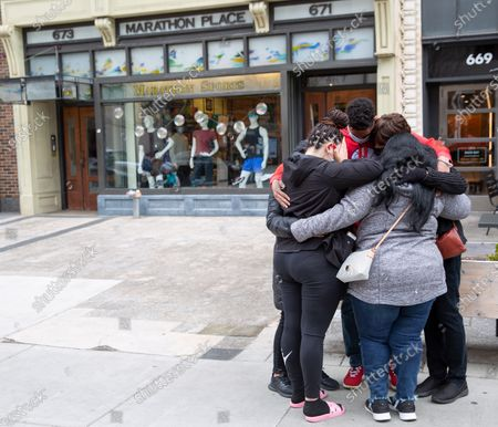 During a moment of silence on the eighth anniversary of the Boston Marathon Bombing, friends and members of the Perez family embrace at the spot where they survived the bombing, in Boston, Massachusetts, USA, on 'One Boston Day', and the eighth anniversary of the bombing, 15 April 2021. On 15 April 2013, two pressure cooker bombs were detonated by the Tsarnaev brothers, Tamerlan and Dzhokhar, near the finish line, killing three spectators and injuring over 250 others. Tamerlan was later killed in a shoot out with police and Dzhokar captured and later sentenced to death following a trial, that was since vacated in July 2020 and is now awaiting a new trial. The Boston Marathon 124th running was cancelled in 2020 due to the coronavirus pandemic and the 125th is now scheduled to be held on 11 October 2021.
